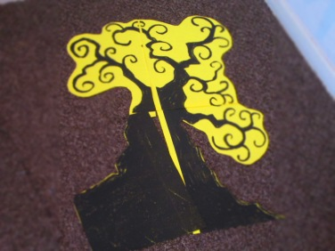 I cut out the tree leaving some of the yellow for eases as the background is the same colour.