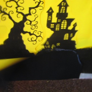 cut out the silhouette mound and blue-tacked it to the wall.
