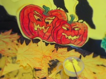 Then I painted the halloween pumpkins face with one coat of yellow acrylic, so it shows both the orange beneath as a glow effect.