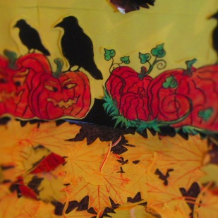 I then moved the pumpkins down to the bottom of the wall display and trimmed the crows feet so the yellow outline is gone, so they are on the punkins.
