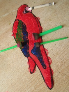 Paint parrots wings and body as shown.
