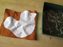Cut out body template and pint to two pieces of brown felt.
