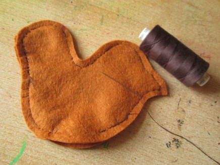 Sew to gather as shown, with machine or back stitch by hand, leaving a 1 inch gap at the bottom middle.