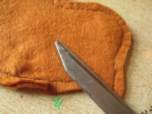 Cut slits in seam , just before stitching to give flex.