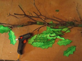 Glue gun leaves to ends of branches.