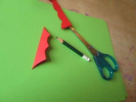 Cut out holly shape as shown.