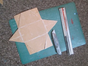 Cut out with Stanley knife, safety rule and score folds to bend.