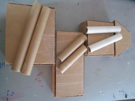 I made 3 rectangle boxes out of corrugated card and got 3 cling flim tube cut down as shown.
